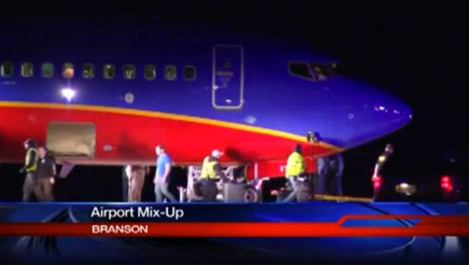 This frame grab provided by KSPR-TV shows a Southwest Airlines flight that scheduled to land Jan. 12 at Branson Airport in southwest Missouri.