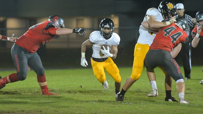 Merritt Island High's Deben Peterson finds an opening for a touchdown during the first half against Satellite High.