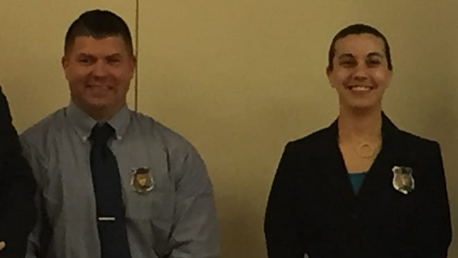 Nolen Gossett IV and Amanda Angles were sworn in as officers with the Newark Police Department Monday.
