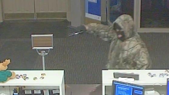 A masked gunman robbed the First Merit Bank, 1277 Ashland Road, at 12:14 p.m. today.