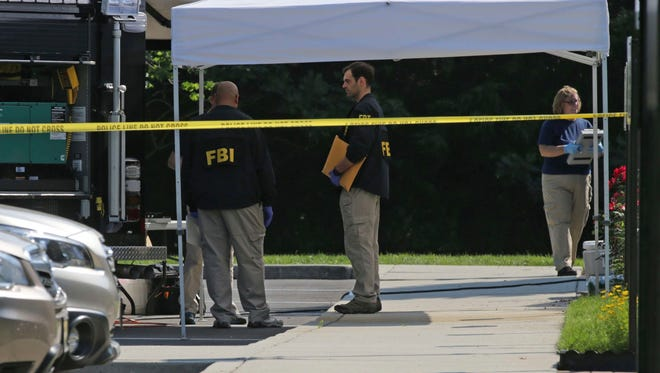 Investigators execute a search warrant at Dr. James Kauffman's office Tuesday, June 13, 2017, in Egg Harbor Township, N.J.