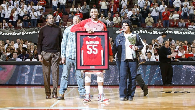 Ohio State's Trey McDonald with his family on Senior Day, playing his final home game with the Buckeyes.