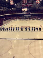 The Northeastern University Huskies and the Bentley University Falcons are introduced prior to a game.
