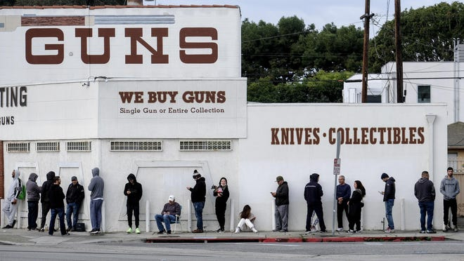 People wait in a line to enter a gun store in Culver City, Calif., on March 15.