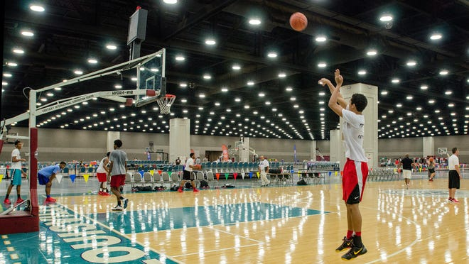 The Arkansas Wings 16-and-under team practices for the Amateur Athletic Union (AAU) Boys Basketball Elite Tournaments in the North Wing of the Kentucky Exposition Center. July 22, 2014