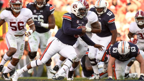Jeremy Johnson (6) looks for running room in Saturday's Iron Bowl.