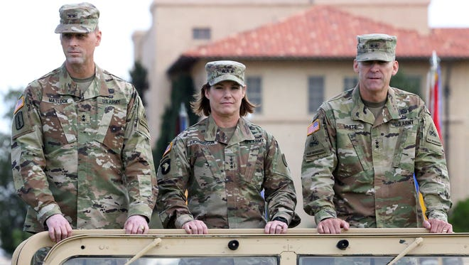 Lt. Gen. Laura J. Richardson, center, was the first woman to lead the U.S. Army Forces Command as its acting commander.
