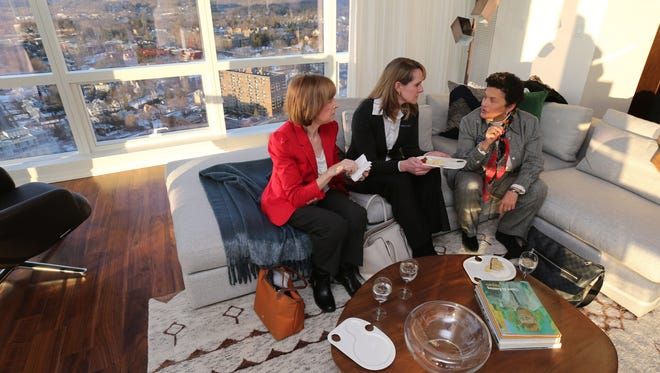Mary Frances Cone, Fiona Dogan and Linda Darer, realtors with the Julia B. Sotheby's in Rye, along with other real estate agents, take an open house tour of Penthouse C at The Residences at The Ritz-Carlton in White Plains, Jan. 27, 2016. Condominium sales in Westchester for 2015, went up by more than 20 percent from 2014.