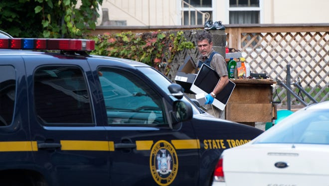 Evidence is removed from an apartment on McKinley Avenue in Endicott during a September 2015 investigation into a conspiracy to distribute steroids.