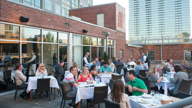 On a recent April night, outdoors dining at the Watermark.  KD Sorenson / For The Tennessean