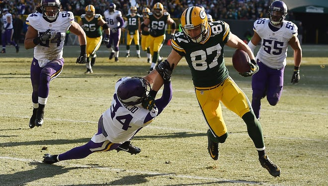Jordy Nelson of the Green Bay Packers breaks a tackle by Andrew Sendejo of the Minnesota Vikings during the second quarter.