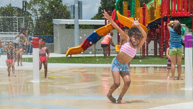 Children playing in the water in the splash pad at St. Julien Park- Saturday, July 8, 2017.