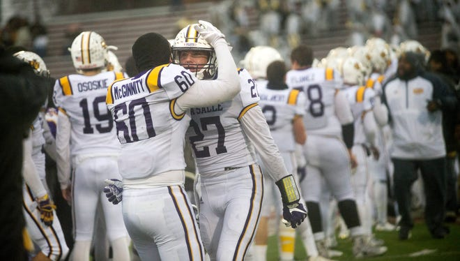 From left, De La Salle players Michael McGinnity and Jacob Dobbs react after the Pilots beat Detroit King, 14-13, on Saturday, Nov. 18, 2017 at Hazel Park High School in Hazel Park.