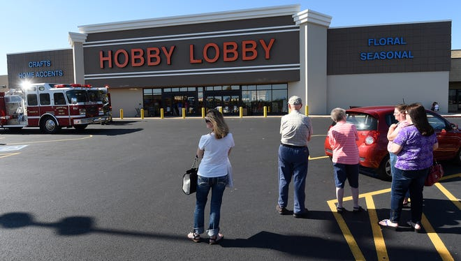 Customers stand in the parking lot while Mountain Home firefighters respond to a call for the smell of smoke inside Hobby Lobby on Tuesday afternoon.