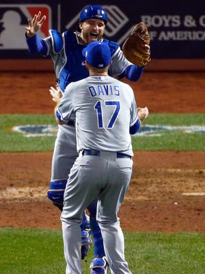 No. 17 Wade Davis of the Kansas City Royals celebrates with Drew Butera of the Kansas City Royals after defeating the New York Mets to win Game Five of the 2015 World Series in New York.