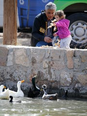Pablo Vargas shared some time with his granddaughter, Taylor Caterina 2, feeding bread to the ducks at Ascarate Park Lake in 2018.