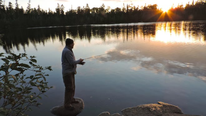 Bedrock slabs on campsites in the Boundary Waters are a quintessential part of the experience. Not only this this bedrock serve as a viewing platform for the northern lights, it also provided Ed with a scenic sunrise fishing spot.