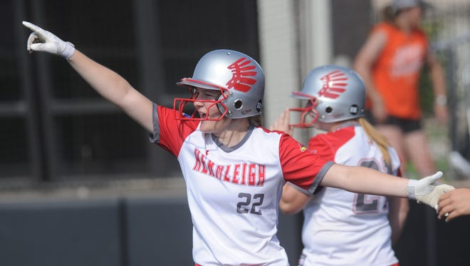 Hermleigh's Kami Smith celebrates after scoring on Brishaya Sneed's two-run single in the fifth inning to cap a six-run inning and break open a 4-4 game. Hermleigh beat Rotan 17-8 in the one-game Region I-1A semifinal playoff Saturday, May 12, 2018 at ACU's Wells Field.