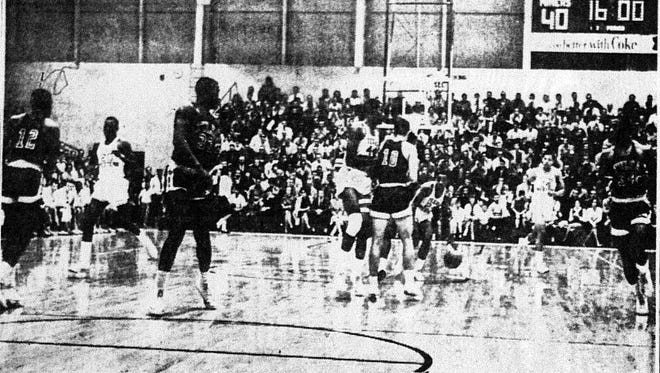 MINERS ON THE MOVE - Texas Western's ninth-ranked basketball Miners(In White uniforms), move into Tulsa territory on the offensive during the second half of Jan. 3 1966's victory-their 11th without a loss this season. Down court from left are Orsten Artis (20), Harry Flournoy (44), Willi Worsley (24) and Bobby Joe Hill (14). Already under the basket i David Lattin. Tulsa players from left are Elridge Webb (12), Herman Callands (33), Gene Demaree (10) and Sherman Dillard (34). Miners won 63-54.