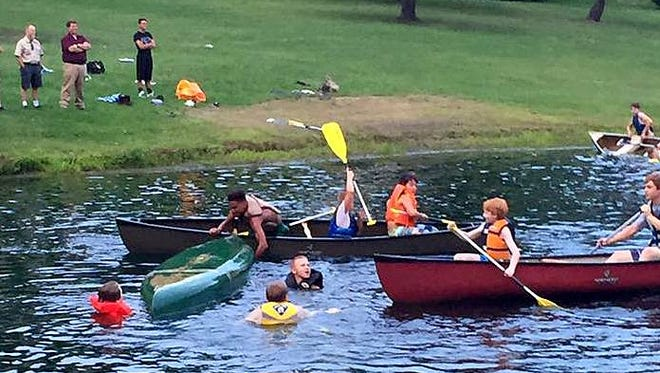 Members of Boy Scout Troop 43 from Pine City practice paddling at Park Station Pond in Erin to prepare for a four-day, 77-mile trip down the Chemung and Susquehanna rivers.