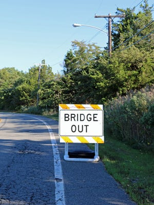 One of several warning signs for vehicles approaching the East Bay Avenue bridge in Barnegat.