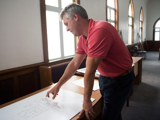 Developer Thomas Krajewski shows potential plans at