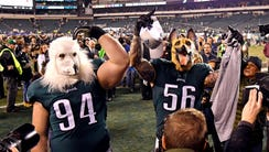 The Eagles' Beau Allen (94) and Chris Long celebrate