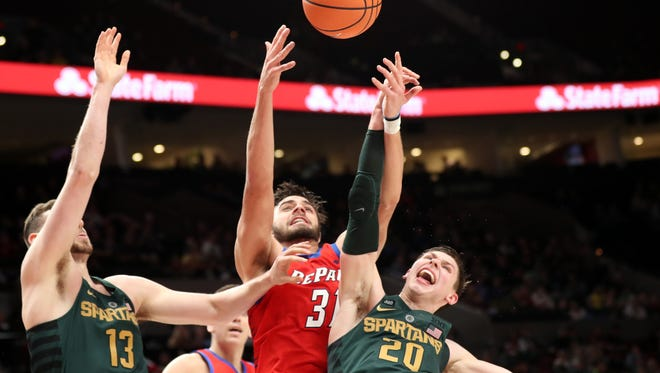 Matt McQuaid battles for a rebound in Thursday's game against DePaul. McQuaid hit six 3-pointers in the Spartans' win at the PK80 Invite in Portland.