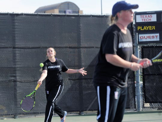 Wylie's Andrea McMillan reaches for a shot behind girls doubles partner Elle Schroeder during the Region I-4A final at Texas Tech's McLeod Tennis Center on Thursday, April 19, 2018. McMillan and Schroeder dropped the championship match, but won 6-2, 6-0 in the playback to finish second and qualify for state.