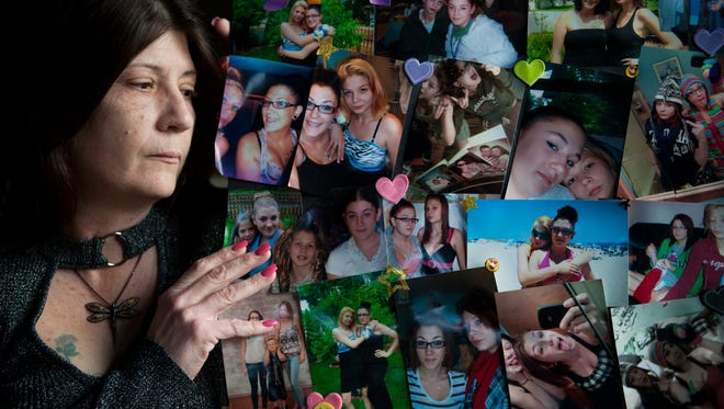 Lisa Vandegrift of Browns Mills holds a collage of her daughters, Sabrina and Stacy, who both became addicted to heroin after they were prescribed painkillers as teenagers. Sabrina, shown with darker hair and glasses, died from a heroin overdose at the age of 20 in 2013. Stacy, now 23, is in recovery from substance use disorder. In response to the opioid epidemic, Vandegrift is lobbying local legislators for a new involuntary treatment law in New Jersey and is  organizing Narcan training classes in Burlington County.