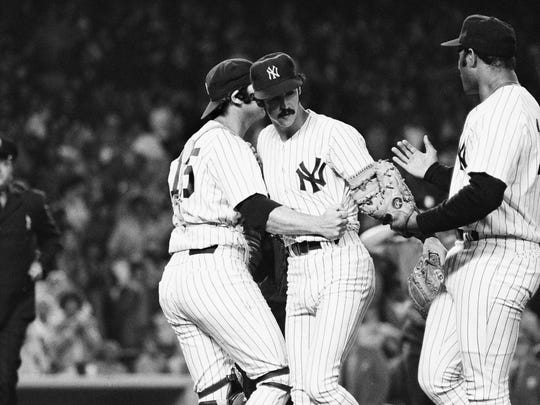 Yankees pitcher Ron Guidry, center, is congratulated by teammates Thurman Munson, left, and first baseman Chris Chambliss after the final out of the game with the California  Angels on June 17, 1978. Guidry struck out 18 batters to set a Yankee record.
