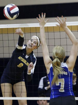 Sutherland's Luisa Schirmer, left, sends a kill past a Schroeder defender during girls volleyball action this past September. Pittsford Sutherland went on to become Class A State champions.
