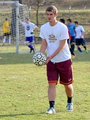 Waynesboro's Burke Bender works with the ball during a varsity boys' soccer practice at Waynesboro High School on Friday.