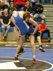 Elmira's Micah Carpenter lifts Serfino Menard of Horseheads in the 145-pound match Thursday in the Section 4 dual meet tournament final at Horseheads High School. Carpenter won by pin in the second period.