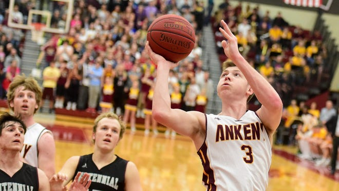 Ankeny's Trystan Cummins goes up for a shot during Friday's game against Ankeny Centennial.
