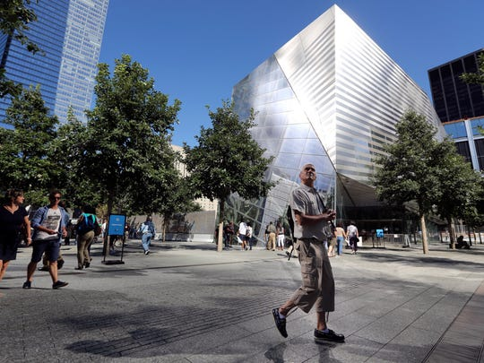 A visitor to the National September 11 Memorial and Museum takes in the sight as he walks past the museum in New York. The museum is dedicated to the victims of the Sept. 11 terror attacks.
