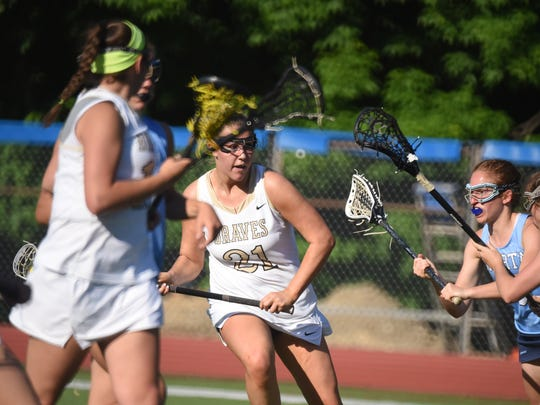 Indian Hills #21 Devin Thompson try to score in the first half Girls lacrosse sectional final No. 1 Indian Hills (white) vs. No. 3 Sparta (blue) North 1, Group 2