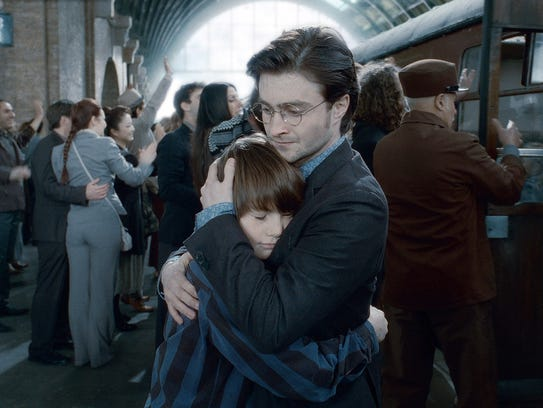 Albus Severus Potter (Arthur Bowen) and Harry Potter