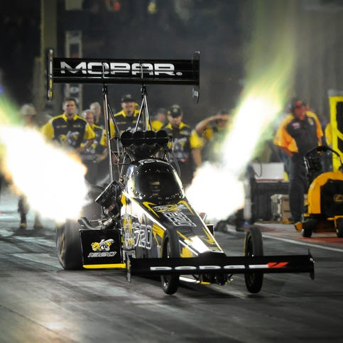 In this photo provided by the NHRA, Leah Pritchett drives in Top Fuel qualifying at the Dodge Mile-High NHRA Nationals drag races at Bandimere Speedway on Saturday, July 21, 2018, in Morrison, Colo. Pritchett powered to a 3.799-second pass at 327.19 mph during the fourth and final round of qualifying to take the top spot heading into eliminations. (Jerry Foss/NHRA via AP)