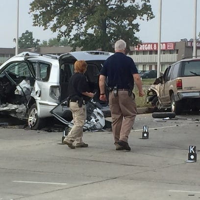 Investigators assess the crash scene Tuesday at Washington