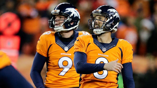 Denver Broncos kicker Brandon McManus (8) watches his field goal attempt go wide with punter Riley Dixon (9) in overtime against the Kansas City Chiefs at Sports Authority Field at Mile High.