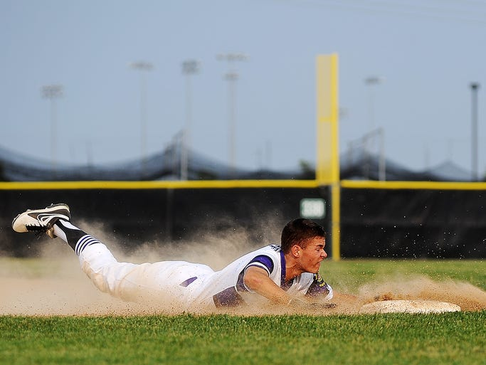 Sioux Falls Post 15 East's Derek Hammer slides safely into third for a steal during a game against Pierre Post 8 on Wednesday, July 9, 2014, at Harmodon Park in Sioux Falls, S.D.
