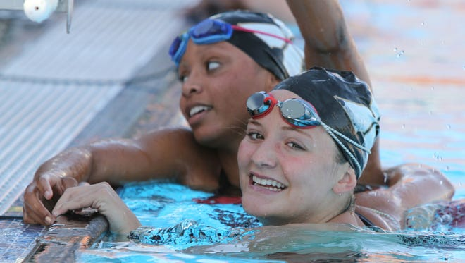 Xavier prep teammates Desiree Lewis (left) and Jillian Barbato are two of the seniors on the DVL champion swim team that has gone undefeated in league races all four years of their careers.