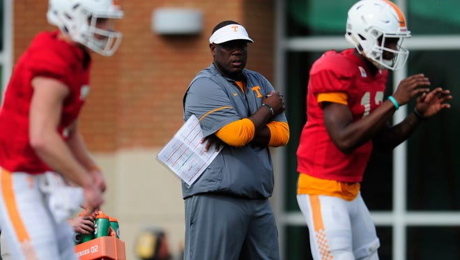 Offensive coordinator Larry Scott  watches during spring practice March 30, 2017.