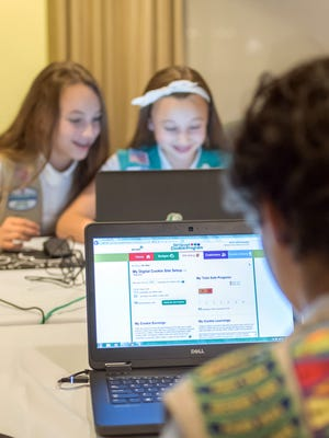 Girl Scouts practice selling cookies online. It's the first time Girls Scouts of the USA has allowed the sale of cookies using a mobile app and personalized websites. The Digital Cookie program is intended to enhance, not replace, traditional use of paper spreadsheets.