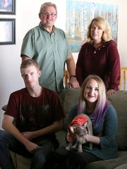 Clockwise from bottom left, Brandon, Mark, Lisa and Haley Vinson pose for a portrait at the family's home in West Jordan on Thursday, Nov. 2, 2017. Brandon Vinson is in recovery from a heroin addiction.