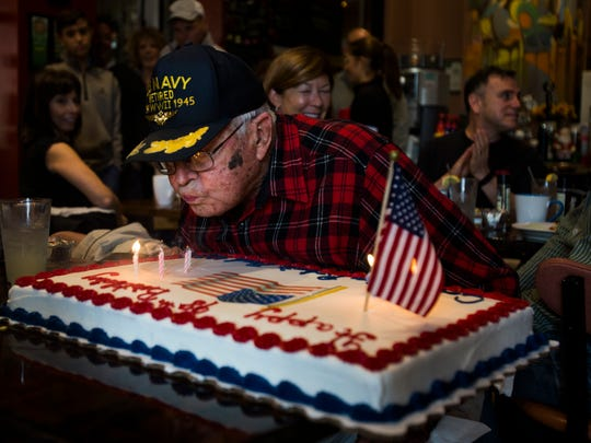 Robert Reed, a World War II U.S. Navy veteran, blows the candles out on his surprise birthday cake at EJ's Bayfront Cafe on Saturday, December 10, 2016 in East Naples. Reed celebrated his 98th birthday with his two friends, Ronn Ginn and Dave Marger, by flying to Naples from St. Petersburg for breakfast. Ronn Ginn orchestrated the surprise at the restaurant.