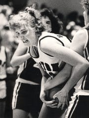 JANUARY 1988: Seton center Janet Haneberg grapples