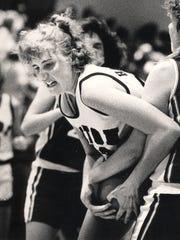 JANUARY 1988: Seton center Janet Haneberg grapples