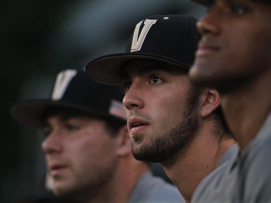 Tyler Green, left, Dansby Swanson, center, and Liam Sabino watch the opposing team warming up before an NCAA regional baseball game on Saturday, May 30, 2015.